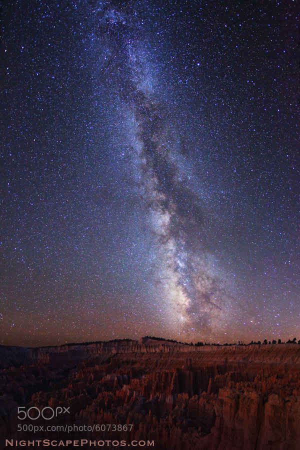 """Starry night sky over the Bryce Canyon Amphitheater in Bryce Canyon National Park. I am at Sunset Point, looking south to Inspiration Point.  Virtually all my NightScapes are ONE exposure (less than 30 seconds), and with very little Photoshop correction. For more how-to and behind the scenes information, visit my <a href=""""http://intothenightphoto.blogspot.com/"""">Into The Night Photography</a> blog. For Milky Way photography workshops, visit my <a href=""""http://intothenightphoto.blogspot.com/2013/11/royce-bairs-2014-photography-workshop.html"""">NightScape Events</a> page. You can <a href=""""http://roycebair.smugmug.com/Personal-Work/Nightscapes/"""">order PRINTS here</a>."""