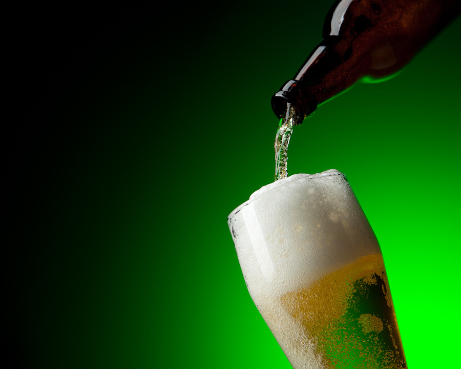 Photograph beer and bootle in dinamic on a green background by  Игорь Климов on 500px