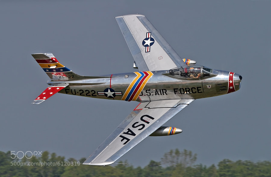 Awesome low, high speed pass by Wyatt Fuller flying his restored F-86E Sabre.  Tragically, this plane and pilot were lost in a crash on 24 July 2006.