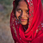 In a park near Jodhpur, we've seen this beautiful Indian girl standing on the side of the way with her husband and her baby. We've compliment her on her new born and she raised head looking at her husband and smiling.