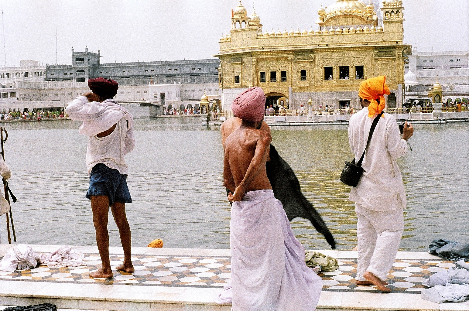 Photograph Sikh pilgrims at the most peaceful Golden Temple, Amritsar, India by Padmakar Kappagantula on 500px
