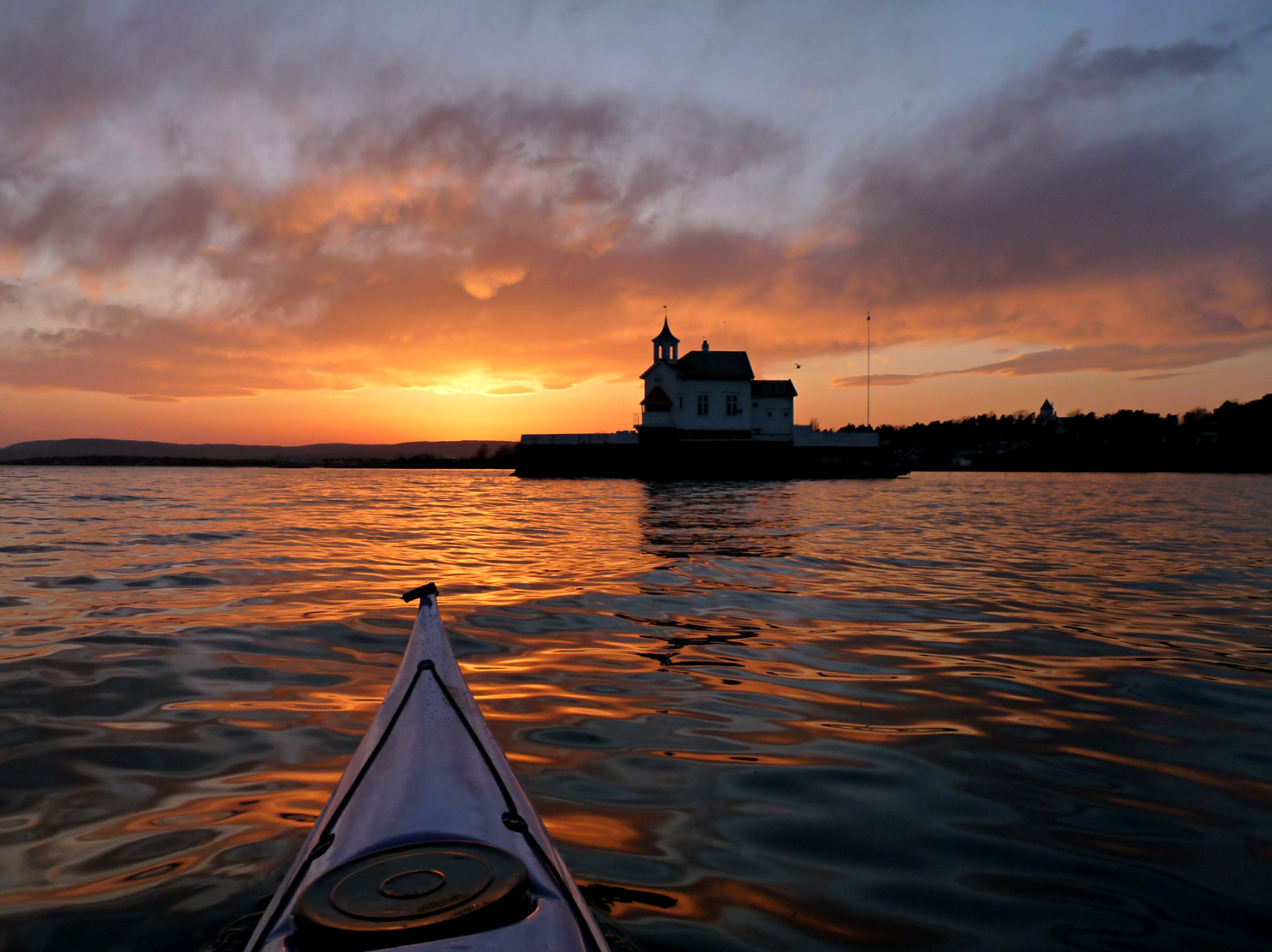 Photograph Sunset from kayak by Päivi Kaarina on 500px