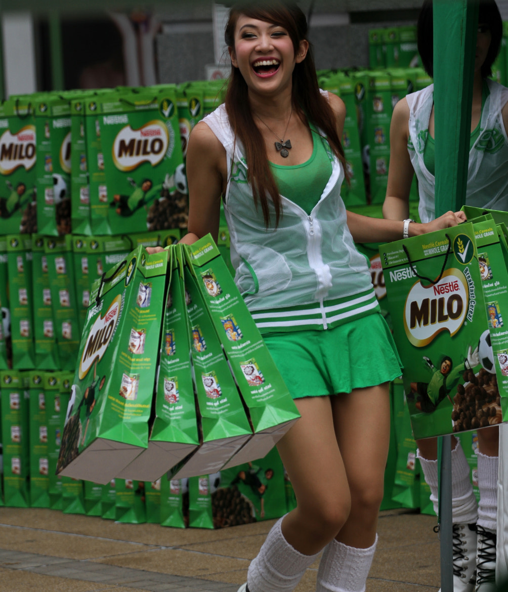 Photograph Thai promo girl smiling by Matthew Richards on 500px