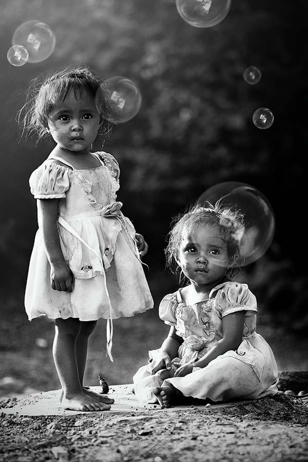 Photograph Twin little girls and the bubbles by Langgeng Arief Utomo on 500px