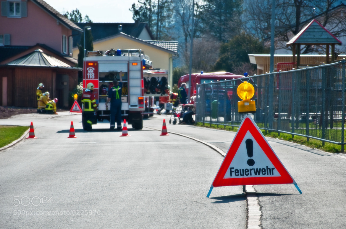 Photograph Firefighters roadblock by Benjamin Stäudinger on 500px