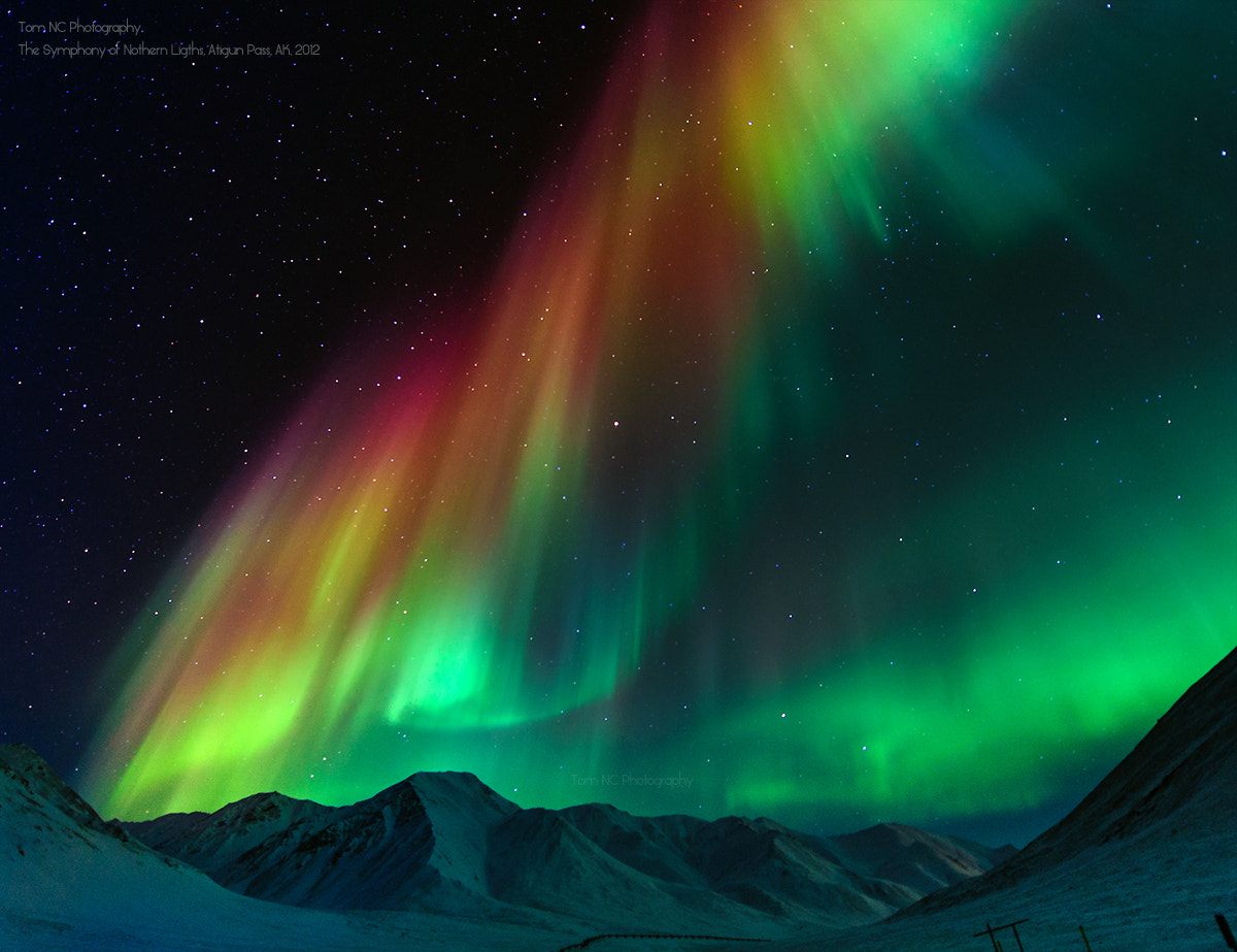 Photograph The Symphony of Northern Lights by Noppawat Charoensinphon on 500px