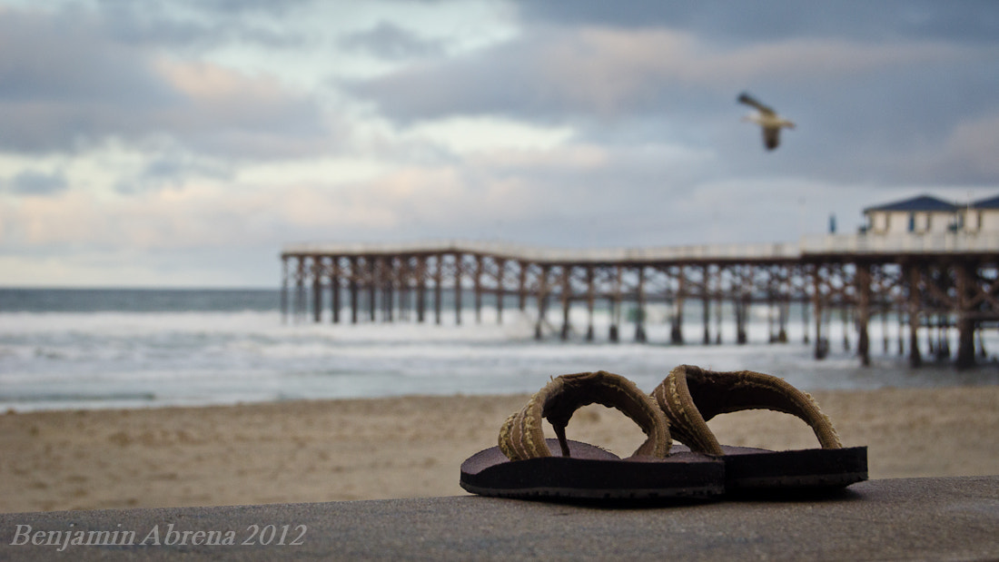 Photograph Abandoned Flip Flops by Ben Abrena on 500px