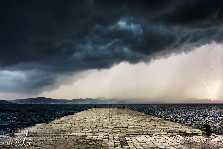 Lightning strikes Ugljan island while cold front led by the shelf cloud approaches Zadar