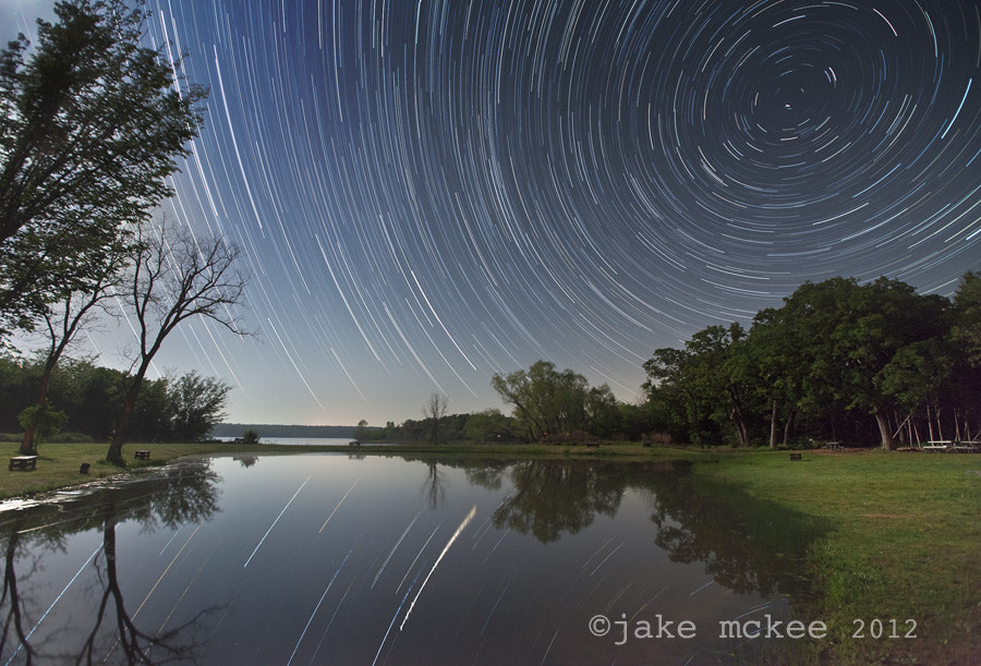 Photograph Star Trails over the Lake by Jake  McKee on 500px