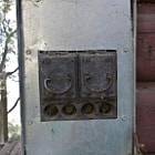 An obsolete Federal Pacific Noark electrical panel that is currently attached to a non operational house in the mountains of Santa Barbara.