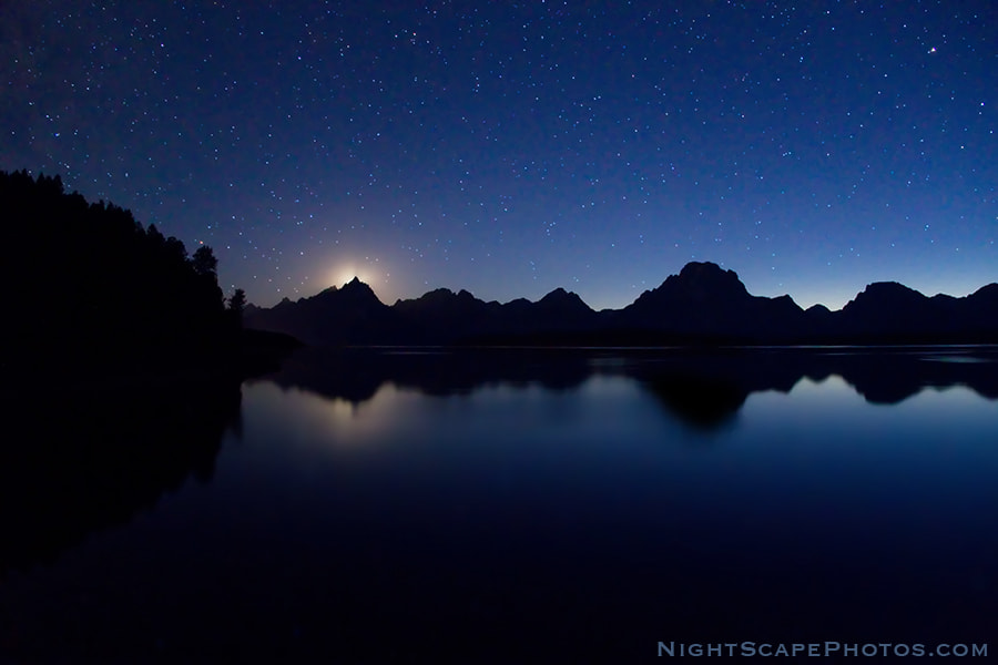 "I caught the last piece of the setting moon as it disappeared behind the Grand Teton peak  in Grand Teton National Park. The sun had set 90 minutes earlier behind the Teton Range, so there was still enough twilight to silhouette and reflect them in Jackson Lake. The brightest stars are still able to compete with the setting moon in this unique evening NightScape.  Virtually all my NightScapes are ONE exposure (less than 30 seconds), and with very little Photoshop correction. For more how-to and behind the scenes information, visit my <a href=""http://intothenightphoto.blogspot.com/"">Into The Night Photography</a> blog. For Milky Way photography workshops, visit my <a href=""http://intothenightphoto.blogspot.com/2013/11/royce-bairs-2014-photography-workshop.html"">NightScape Events</a> page. You can <a href=""http://roycebair.smugmug.com/Personal-Work/Nightscapes/"">order PRINTS here</a>."