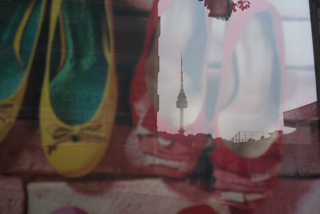 Photograph Seoul N tower though glass by CH Han on 500px