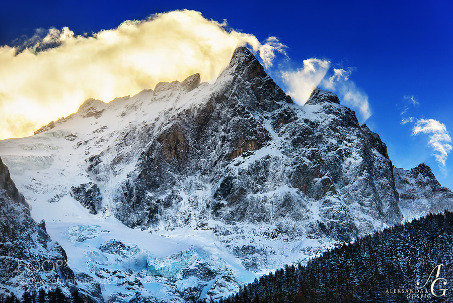 Mighty La Meije (3984m / 13,071ft) and its north wall, the second highest mountain in the wild Ecrins group in the French Alps, rips the clouds carried by a strong SW wind