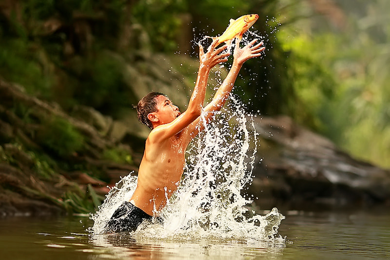 Photograph Catching A Fish by Rizal Arnex on 500px