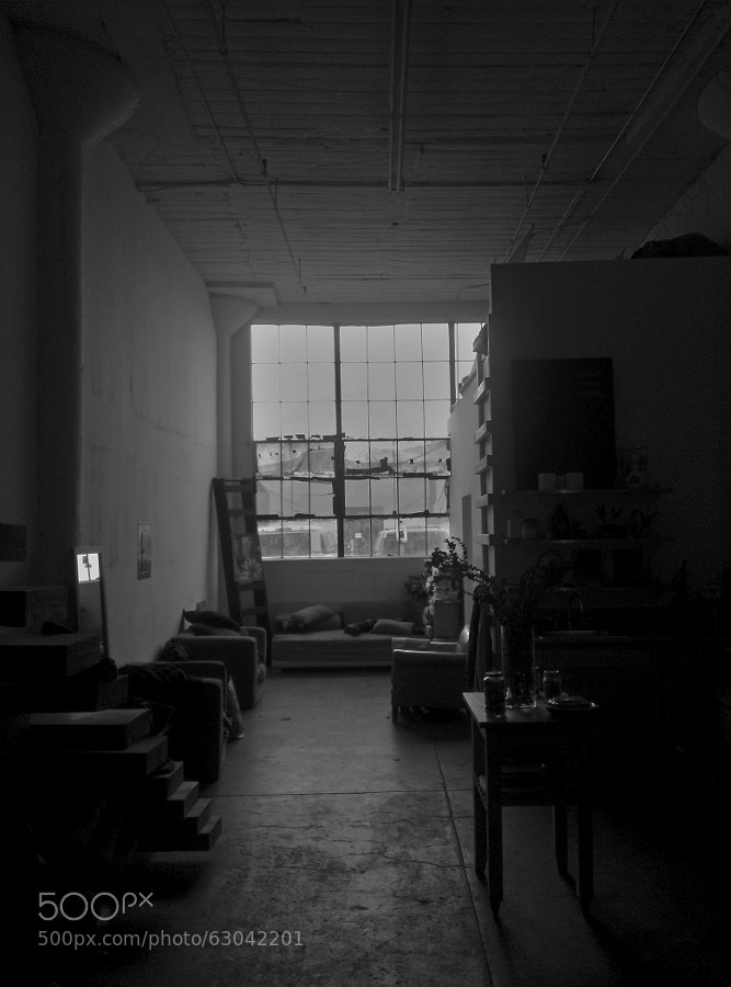 Looking towards the window on a rainy day inside a Downtown loft in Los Angeles.