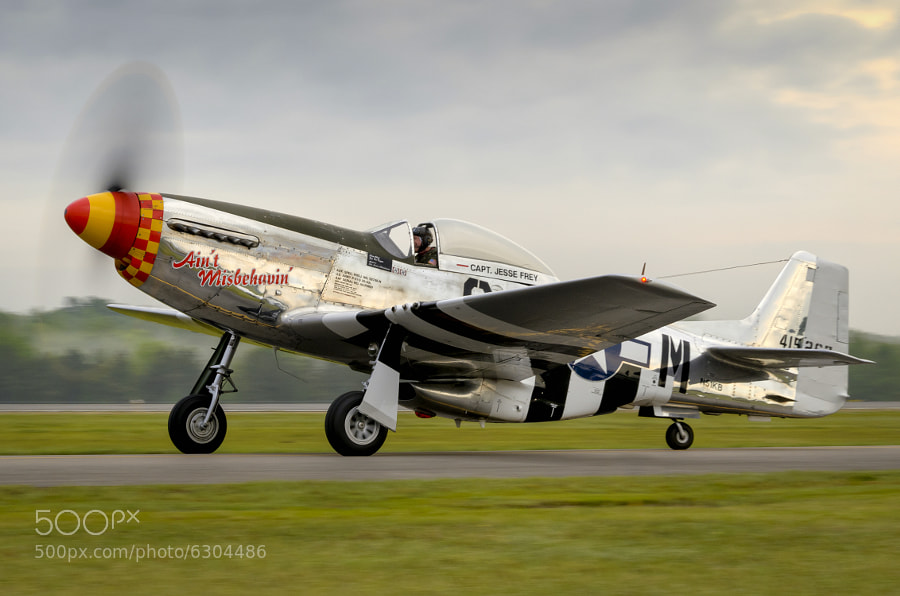 "P-51C Mustang ""Ain't Misbehavin"" taxis to the ramp in the early morning at the 2012 Tuscaloosa Airshow"