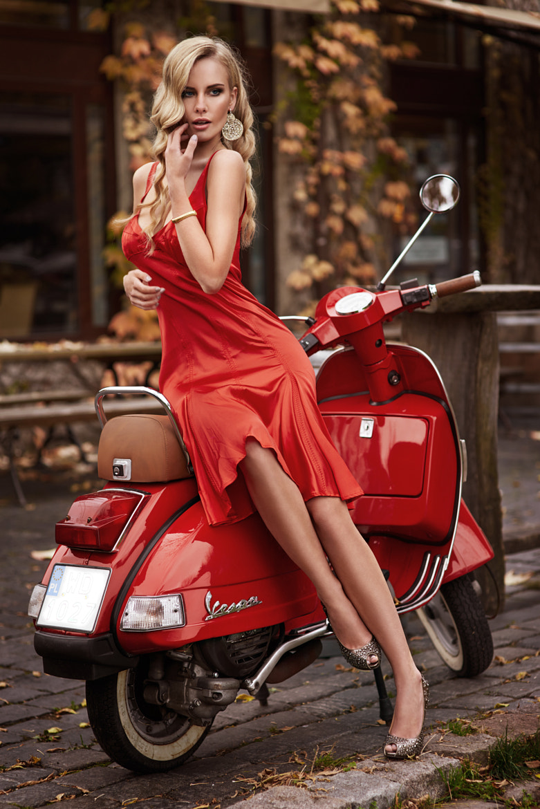 Photograph Woman in red by Lukasz Ratajak on 500px