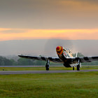 P-51C Mustang Ain't Misbehavin' taxis to the ramp in the early morning at the 2012 Tuscaloosa Airshow
