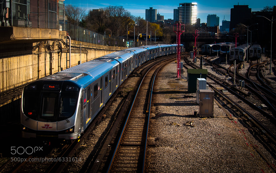 A boy's wonder with the magic of the TTC subway trains never goes away. Indeed, it increases with the passage of time, drawing him back home with a camera. I especially love how you can see the trains of yesteryear in the background as the train of tomorrow is bursting on the scene.
