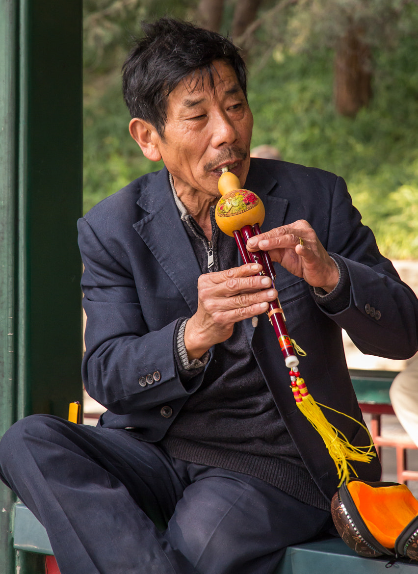 Photograph China - Man playing at Summer Palace by Peter Craig on 500px