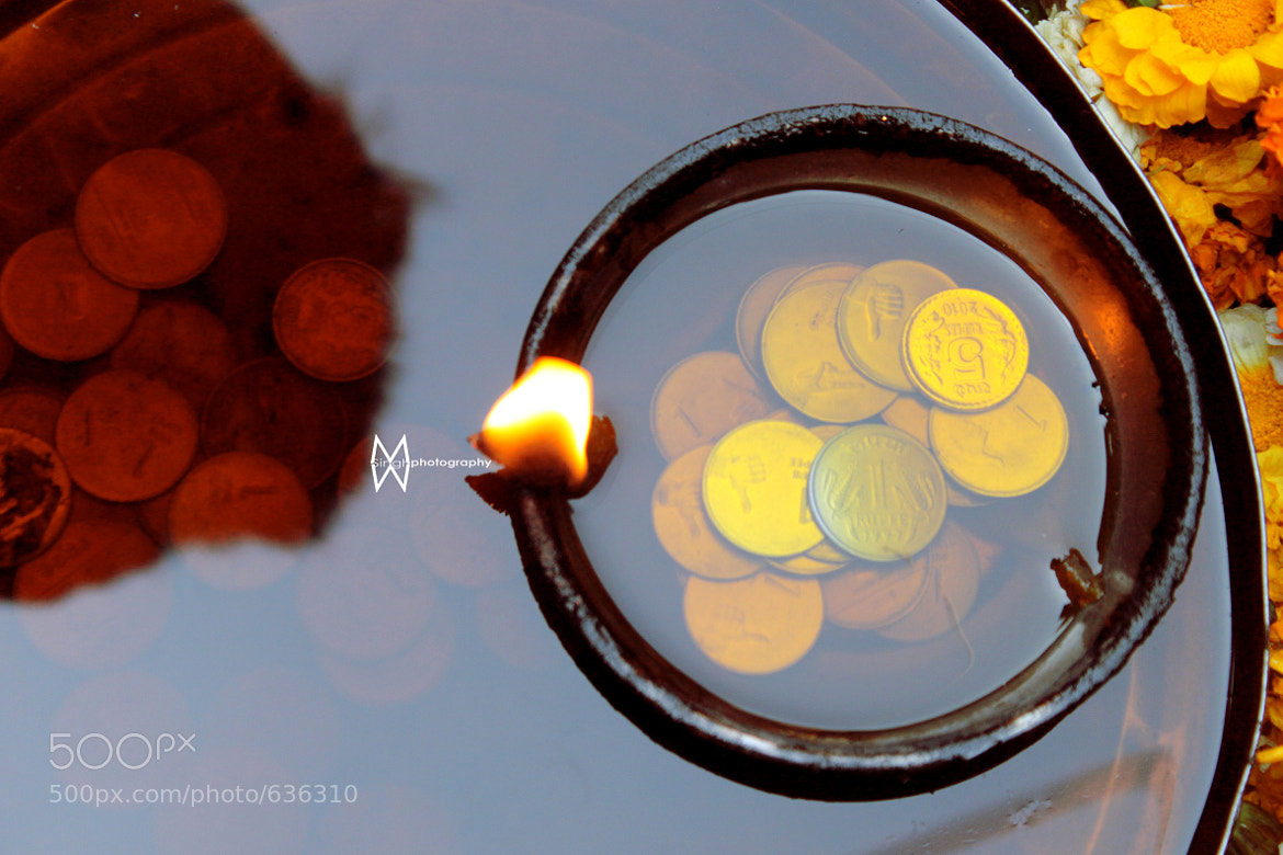 Photograph Coins, oil and a little fire.  by Manuja Singh Waldia on 500px