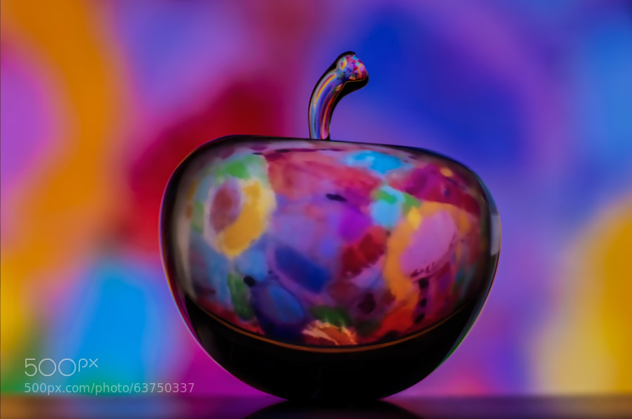 glass apple refracting an abstract painting