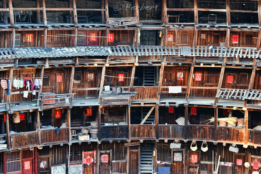 Photograph Neighbours everywhere- Hakka Tulou by Herbert Wong on 500px
