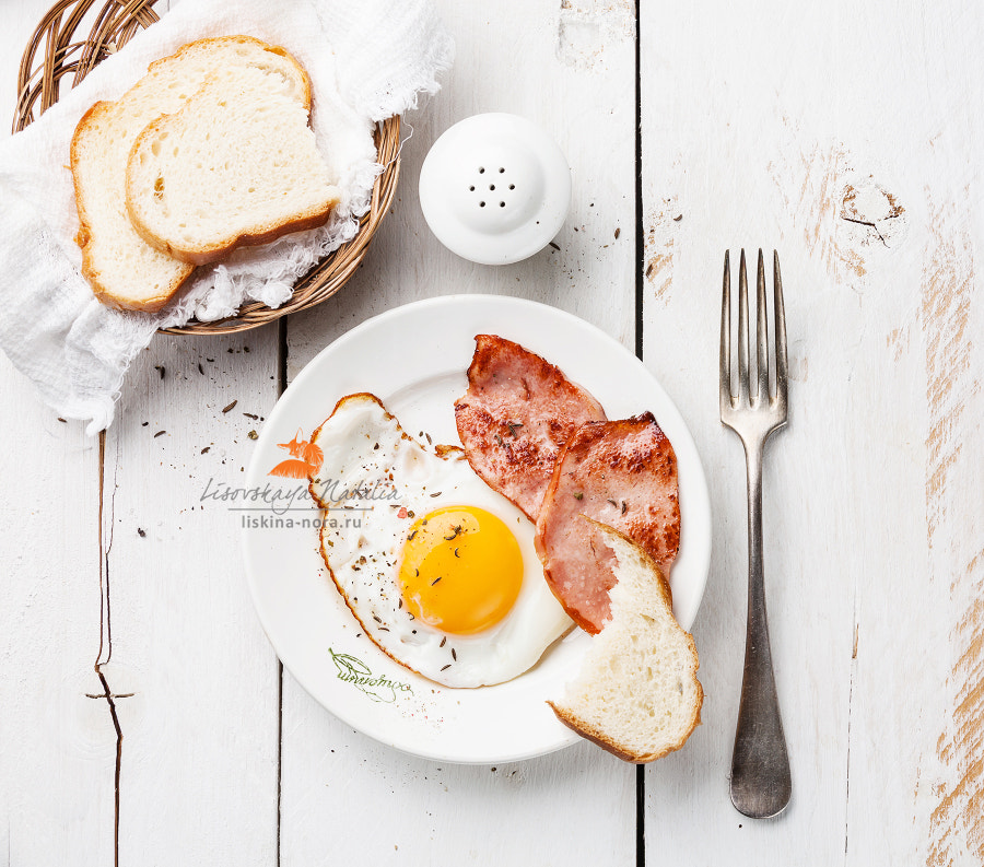 Fried egg with grilled sausage for breakfast