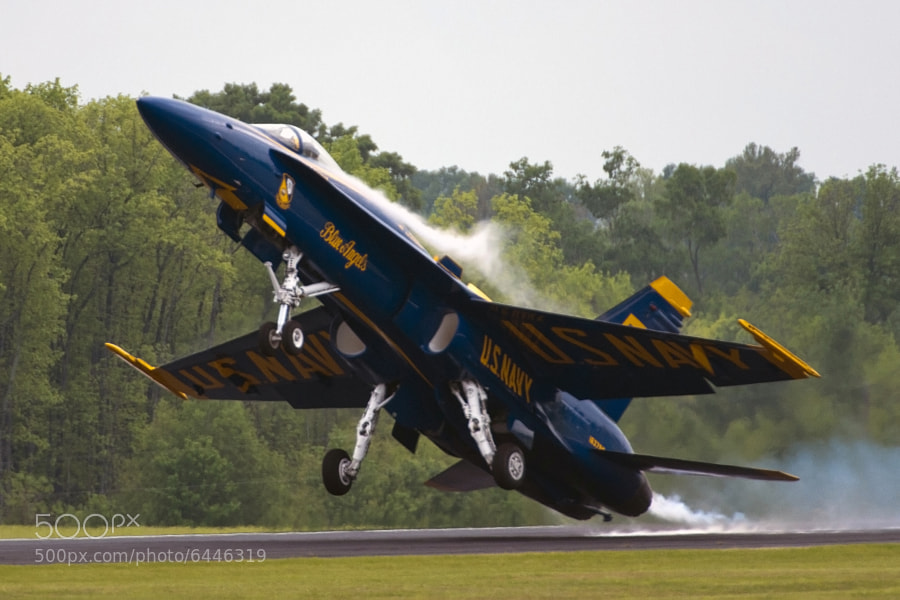 At the Tuscaloosa Regional Air Show it rained hard on Friday, right before the Blue Angels practice show. As a result, the air was full of moisture and it was easy for the F/A-18 jets to pull lots of vapor. Here is BA #5 on takeoff