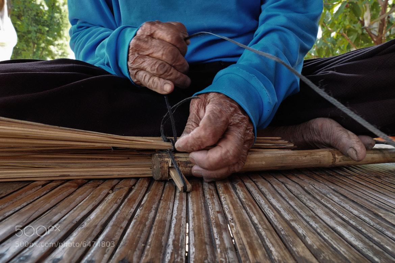 Photograph Thai man making garden brushes by Matthew Richards on 500px