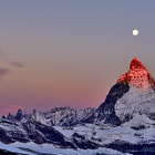 I did have a similar shot to this from a different angle on my site but there were a couple of things I wasn't happy with, so I've changed it.  The Matterhorn at sunrise under the Harvest moon. -8 degrees at an altitude of 3,000m