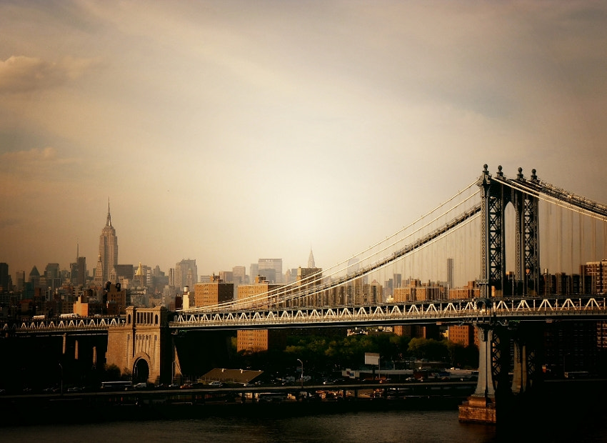 Photograph The Manhattan Bridge and New York City Skyline at Sunset by Vivienne Gucwa on 500px