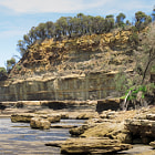 Постер, плакат: cliffs sea ocean and weathered sandstone