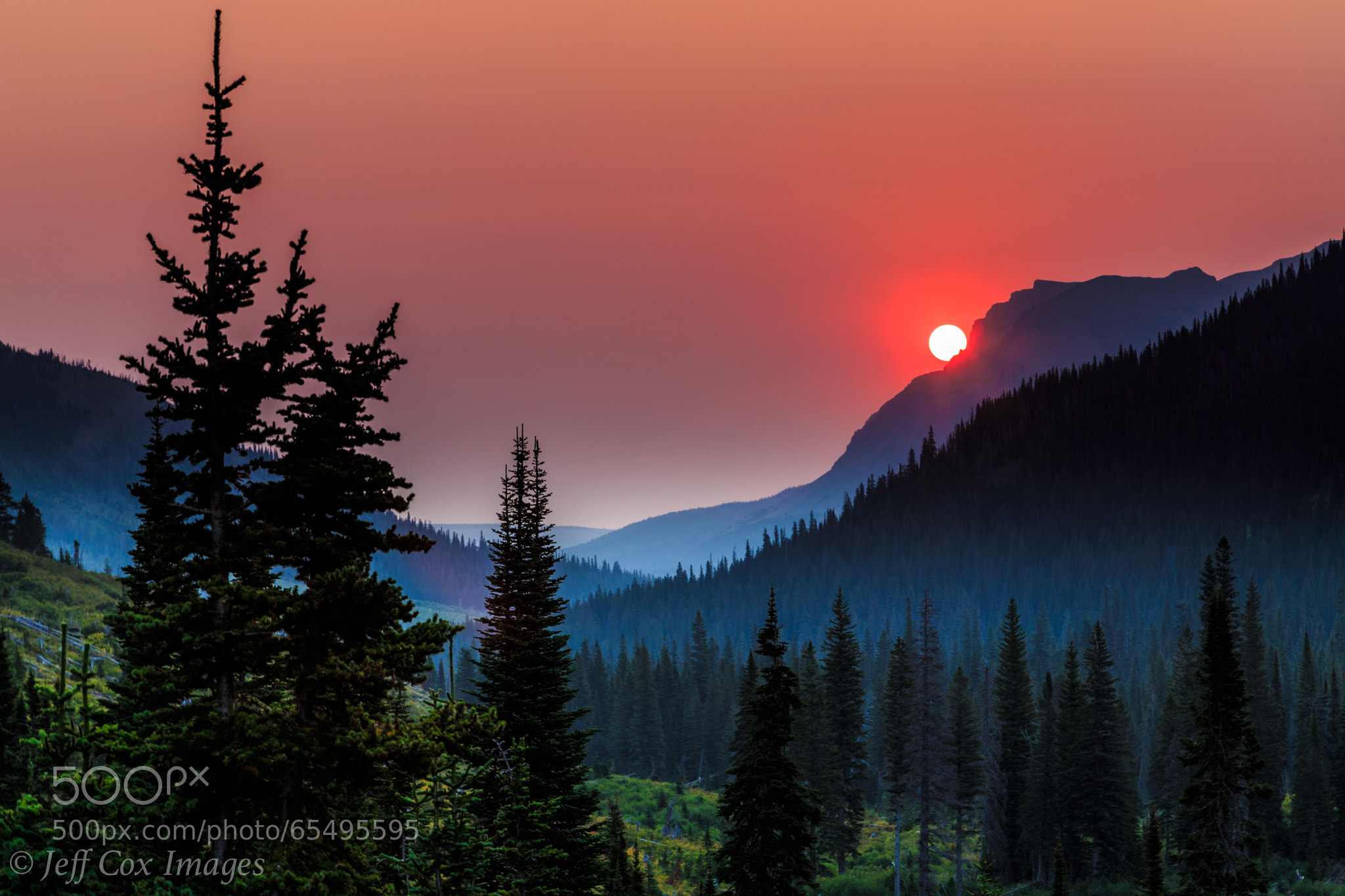 Photograph Smoky Sunrise at Upper Two Medicine Lake by Jeff Cox on 500px