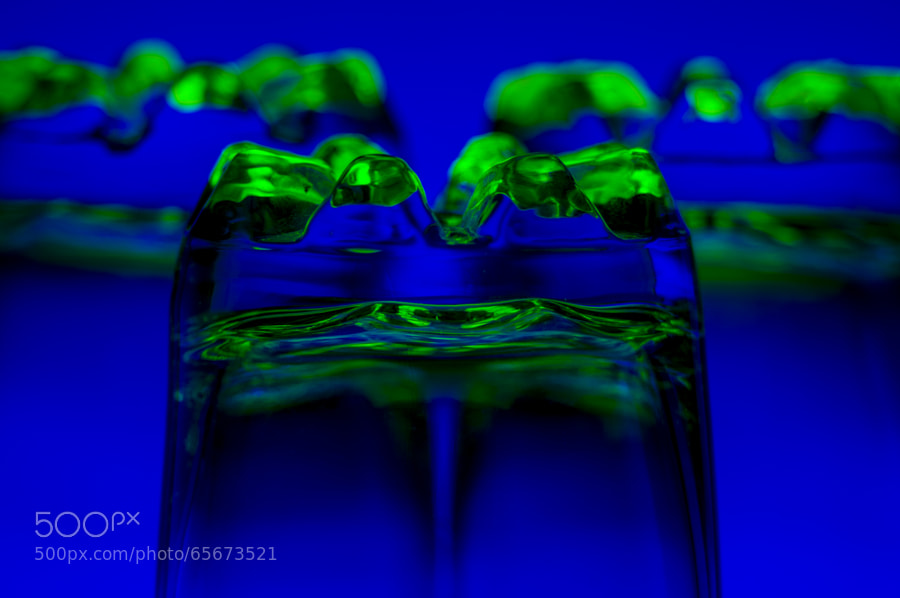 3 Drinking water transparent glasses upside down lit with coloured lights