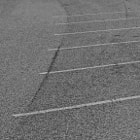 Parking lines painted on the cement on a hill in Tarzana, California.