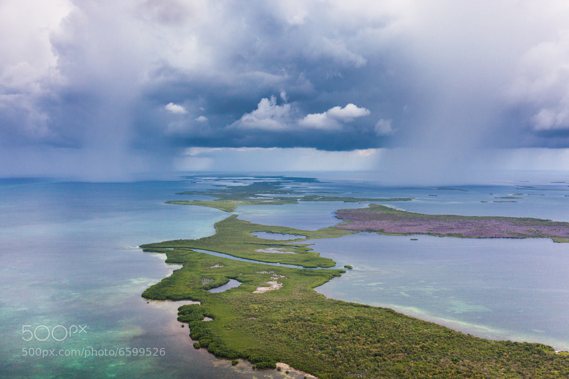 Photograph Isolated Showers over Coral Atoll. by Tony Rath on 500px
