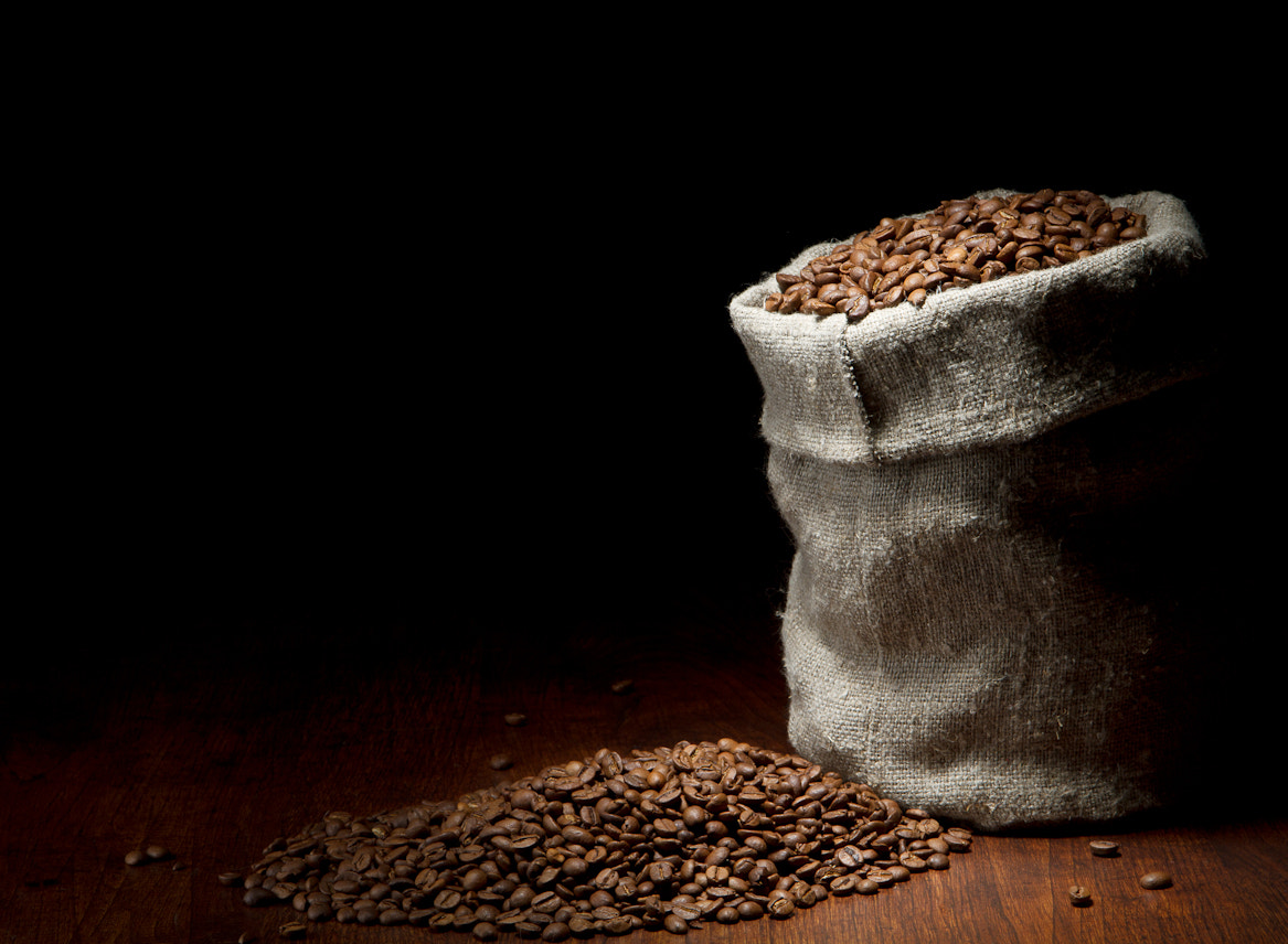 Photograph Burlap sack of coffee beans against dark wood background by  Игорь Климов on 500px
