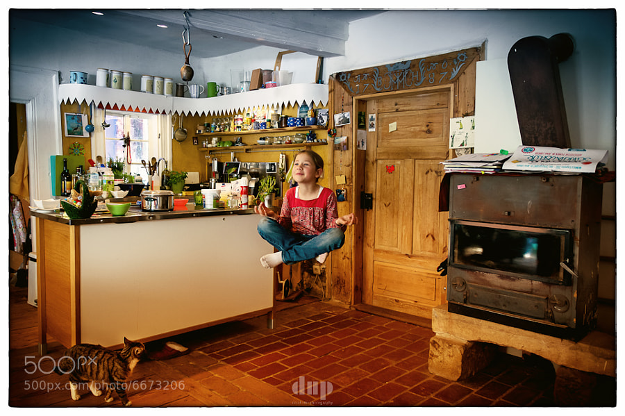 Day 48 of 366</p>  <p>My little sister, calm amongst the chaos that is our kitchen.  I wanted to try some levitation photography, and this is the result. Easier than it seems, although there's lots of little details you gotta pay attention to, lest it looks unnatural.</p>  <p>What are your thoughts on it?