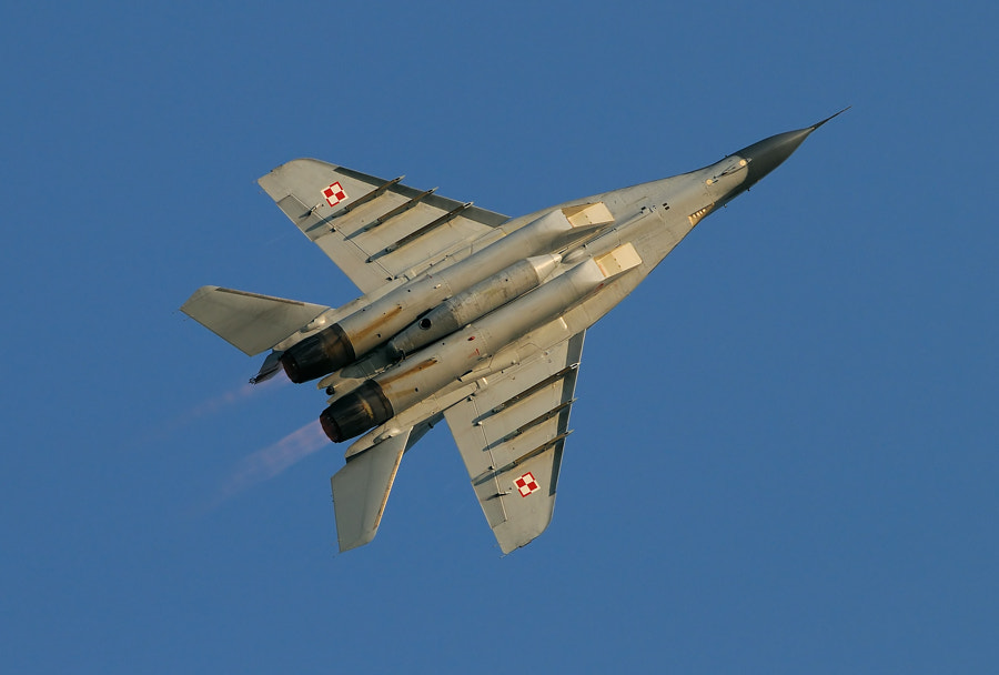 """The Mikoyan MiG-29 (Russian: Микоян МиГ-29; NATO reporting name: """"Fulcrum"""") is a fourth-generation jet fighter aircraft designed in the Soviet Union. Developed by the Mikoyan design bureau as an air superiority fighter during the 1970s, the MiG-29, along with the larger Sukhoi Su-27, was developed to counter new American fighters such as the McDonnell Douglas F-15 Eagle, and the General Dynamics F-16 Fighting Falcon.[6] The MiG-29 entered service with the Soviet Air Force in 1983.  While originally oriented towards combat against any enemy aircraft, many MiG-29s have been furnished as multirole fighters capable of performing a number of different operations, and are commonly outfitted to use a range of air-to-surface armaments and precision munitions. The MiG-29 has been manufactured in several major variants, including the multirole Mikoyan MiG-29M and the navalised Mikoyan MiG-29K; the most advanced member of the family to date is the Mikoyan MiG-35. Later models frequently feature improved engines, glass cockpits with HOTAS-compatible flight controls, modern radar and IRST sensors, considerably increased fuel capacity; some aircraft have also been equipped for aerial refuelling.  Following the dissolution of the Soviet Union, a number of successor states have continued to operate the MiG-29; the largest of which is the Russian Air Force. The Russian Air Force wanted to upgrade its existing fleet to the modernised MiG-29SMT configuration, but financial difficulties have limited deliveries. The MiG-29 has also been a popular export aircraft; more than 30 nations either operate or have operated the aircraft to date, India being one of the largest export operators of the type. As of 2013, the MiG-29 is in production by Mikoyan, a subsidiary of United Aircraft Corporation (UAC) since 2006.  Best wishes and have a nice day,  Harry"""