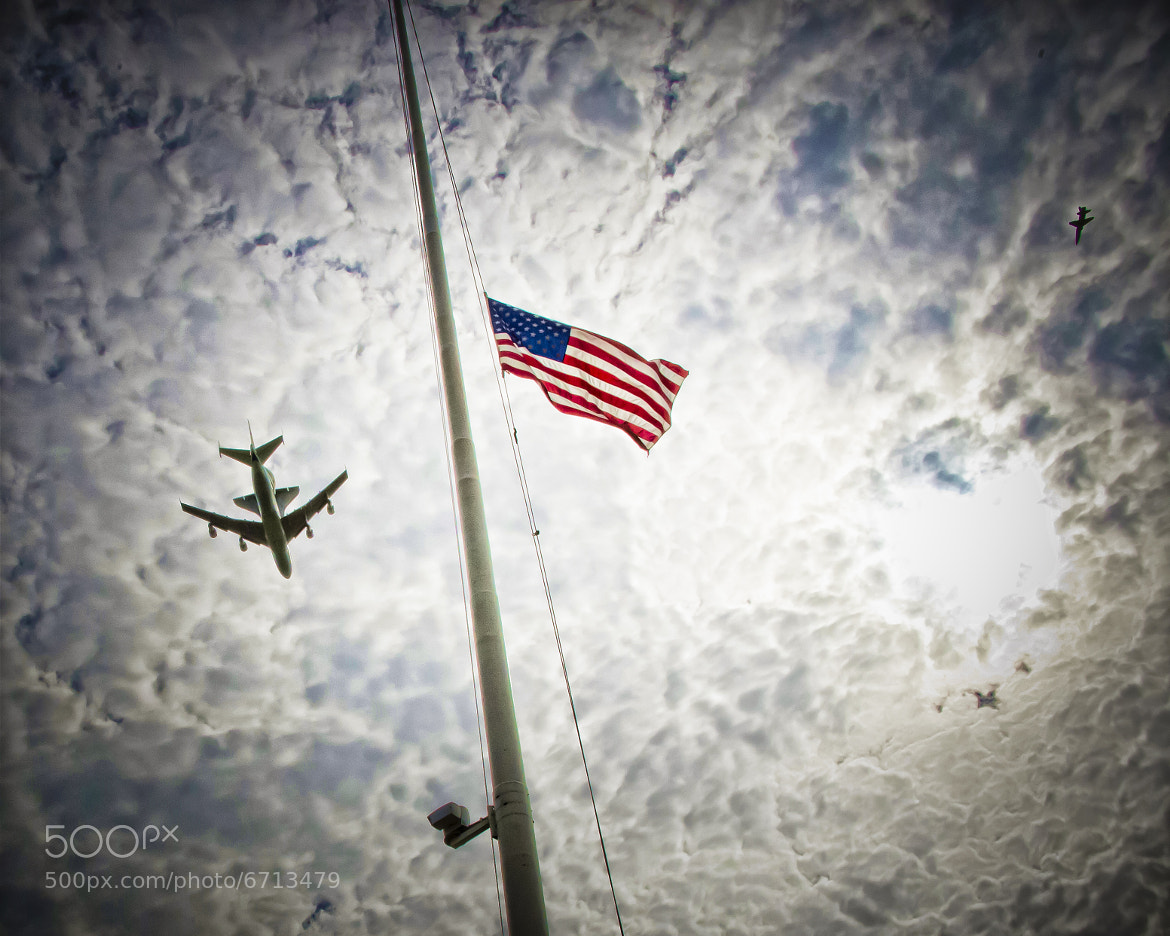 Photograph Space Shuttle Discovery flys past the Arlington National Cemetery flag. by Don Harper at The Edge on 500px