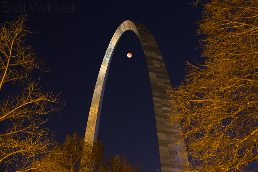 Photograph Eclipse Under the Arch by Brett Weinstein on 500px