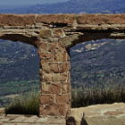Knapp's Castle is a landmark ruined mansion in the Santa Ynez Mountains near Santa Barbara, California. Located near East Camino Cielo in the Los Padres National Forest, the ridge-top site has a panoramic view of Lake Cachuma and the Santa Ynez Valley. It is a popular destination for hikers and photographers.  George Owen Knapp, founder of Union Carbide, built Knapp's Castle shortly after purchasing the 160-acre (0.65 km2) parcel in 1916. In 1940, Frances Holden bought the property and invited her friend, world-famous opera singer Lotte Lehmann, to move in. The mansion was destroyed by a forest fire only five weeks later, and now only the massive sandstone foundations, fireplace pillars and walls of the original seven structures remain intact. The parcel is still privately owned but open to the public. In January 2011, the site was undergoing new construction by the property owner, with a stone amphitheatre-style addition, some reinforcements, and other work. The county ordered a stop to the construction due to a lack of permits, but the construction equipment remains on site.