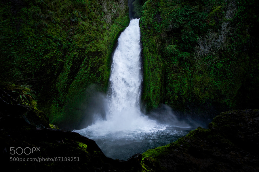 Wahclella Falls was named after a nearby village of Native Americans by the Mazama mountaineering club in 1915. Although Wahclella Falls is its officially recognized name, the United States Geological Survey still records the waterfall as Tanner Creek Falls.