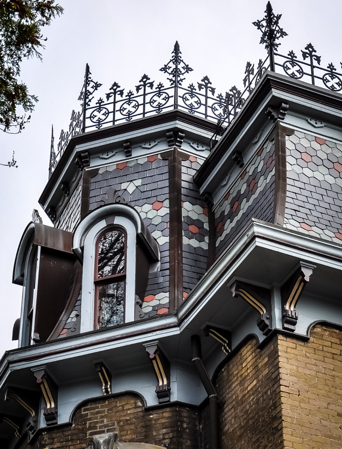 """Sometimes it's hard to grasp what someone was thinking when they designed a house that looks like this. But then, the Victorian era was unique. They might have been impressed by this design but my guess is they were """"not amused."""""""