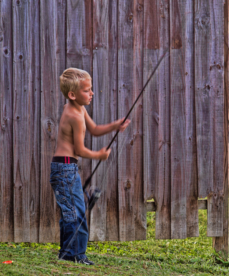Young child with fish pole.