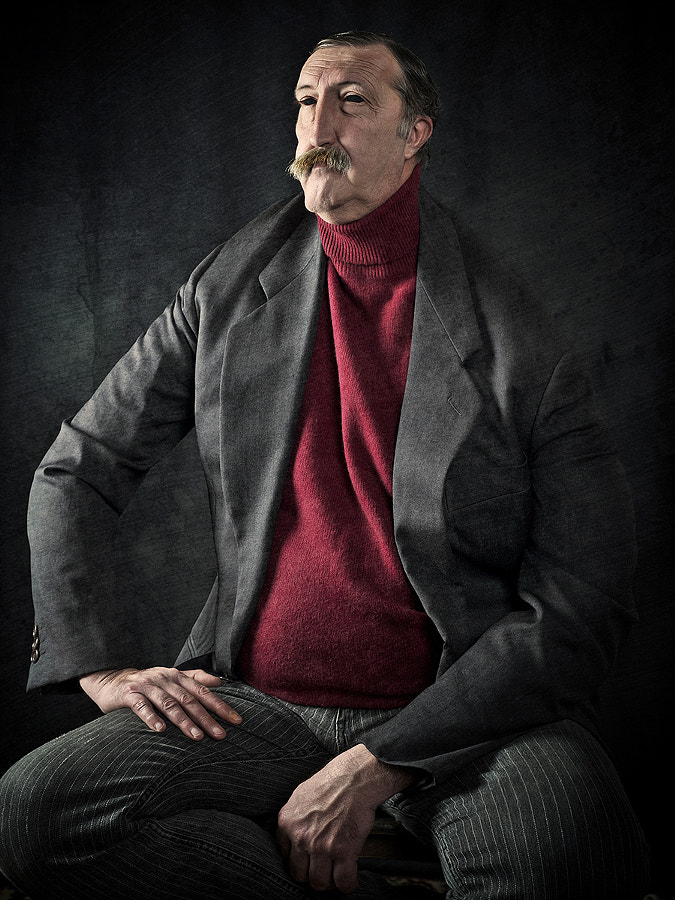 Man with a Big Mustache Sitting