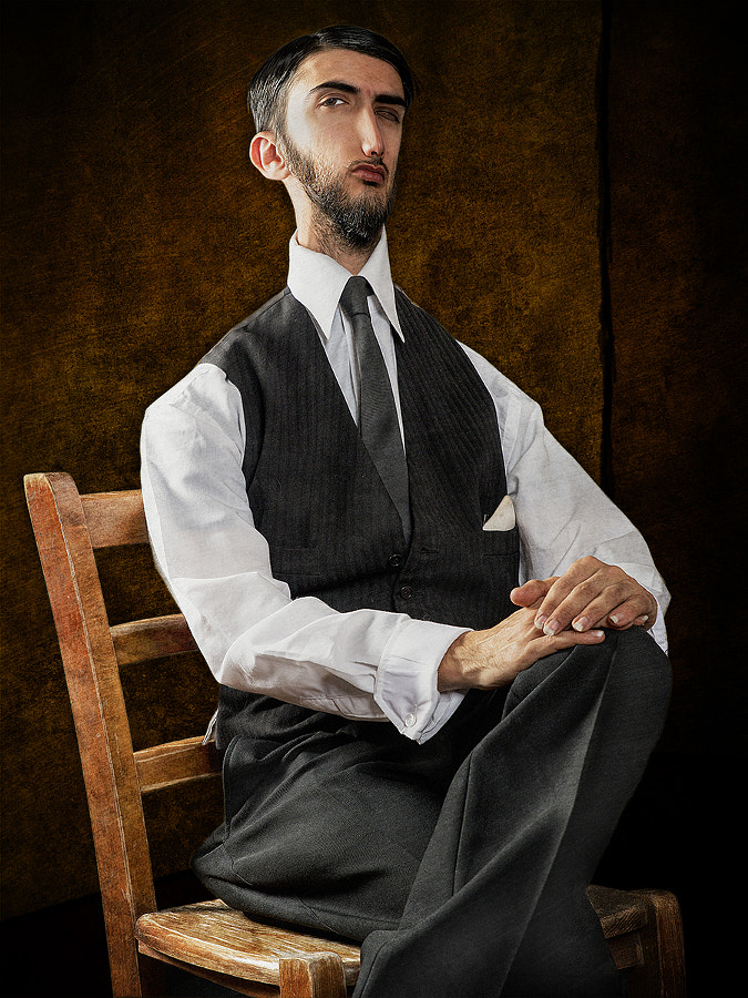 Man Sitting with Tie and Waistcoat