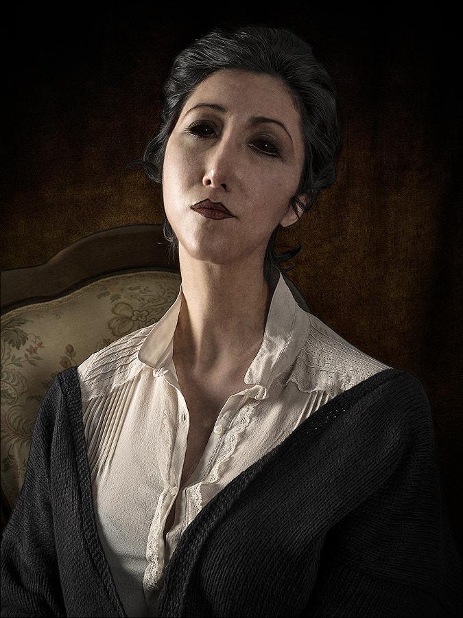 Portrait of brunette woman sitting