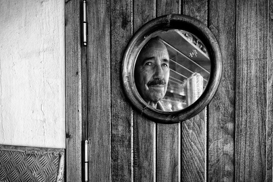 A Man Behind The Window